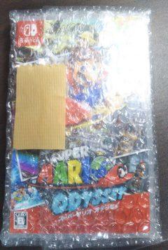 メルカリで売るのにスイッチのソフトを梱包し布テープでふさぎます